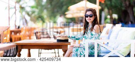 Portrait Beautiful Women Sitting On Wooden Sofa. Happy Woman Sweet Smiling. Person Wearing Sunglasse