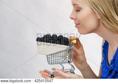Young Female Holding Fresh Blackberry Fruits Box In Shopping Cart. Healthy Seasonal Fruit, Organic N