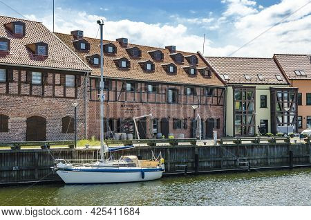 Klaipeda, Lithuania - Juny 24, 2021: Beautiful View On Tourist Boat, Dane River, Embankment And Red