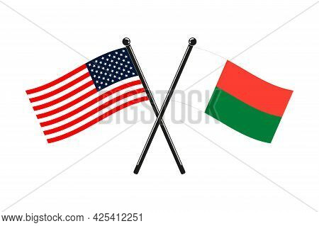 National Flags Of Madagascar And Usa Crossed On The Sticks In The Original Colours