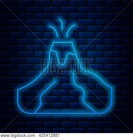 Glowing Neon Line Volcano Eruption With Lava Icon Isolated On Brick Wall Background. Vector