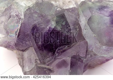 Macro Mineral Stone Fluorite Crystal On A Black Background Close-up