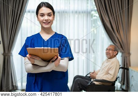 Portrait Of Happy Asian Beautiful Nurse Caregiver Woman Smile, Look At Camera After Visit And Examin