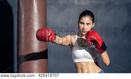 Asian Beautiful Sport Boxer Wear Boxing Glove Practice Punch In Gym. Attractive Active Athlete Fight