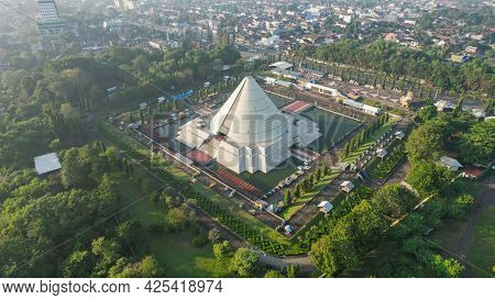 Aerial View Of Monument To The Recapture Of Yogyakarta. Historical Building In A Cone Shape. Monjali