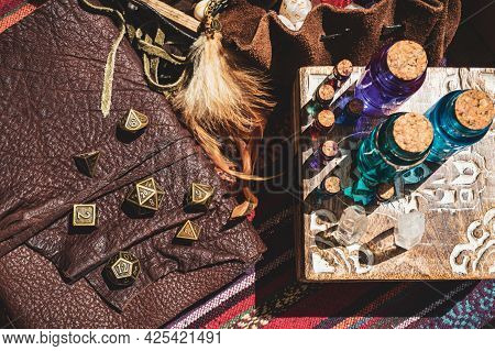 Overhead Image Of Glass Stopper Bottles With Colored Liquid On A Wooden Box, Metallic Rpg Gaming Dic