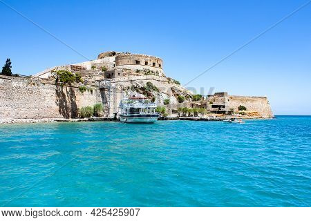 Abandoned Old Fortress And Former Leper Colony, Island Spinalonga, Crete, Greece. Ruined Old Buildin