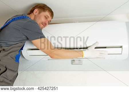 The Master Of Air Conditioning Maintenance In Work Clothes Treats His Work With Love. A Concept That