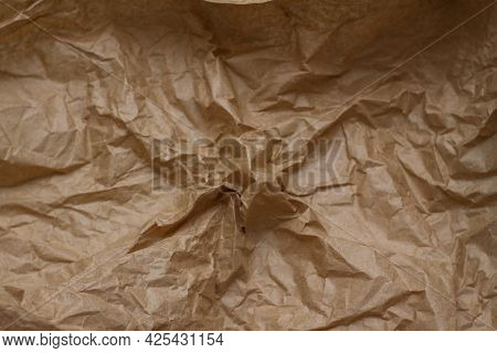 Crumpled Paper. Craft Paper. Texture, Background, Folds.brown Crumpled Paper