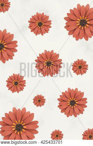 Orange paper craft daisy pattern on beige background