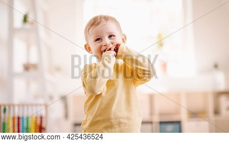 Cute Boy Standing In The White Room