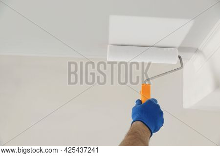 Handyman Painting Ceiling With White Dye Indoors, Closeup. Space For Text
