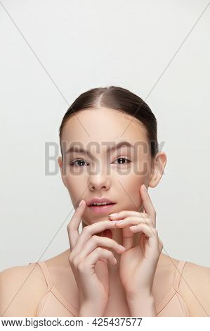 Portrait Of Beautiful Young Woman Isolated On White Studio Background. Concept Of Beauty, Tenderness