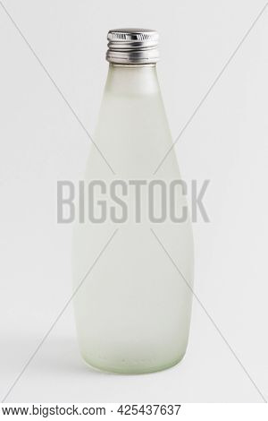 Water in a translucent glass bottle mockup