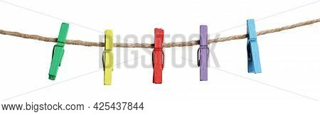 Many Colorful Wooden Clothespins On Rope Against White Background