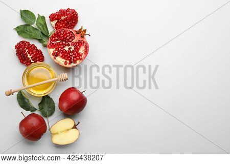 Flat Lay Composition With Rosh Hashanah Holiday Attributes On White Background. Space For Text