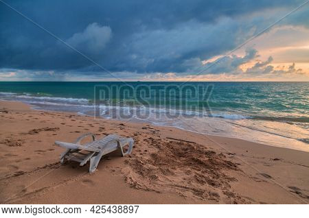 Chaise longues on the beach at sunset. Thailand