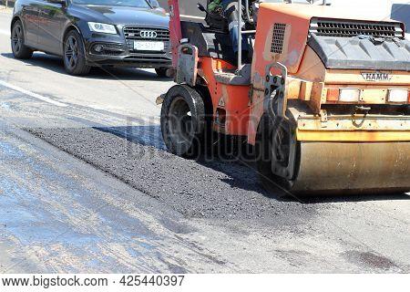 Ukraine, Odessa, Summer 2021. The Rollers Machine Is Repairing The Road. Repair, Complicated Transpo