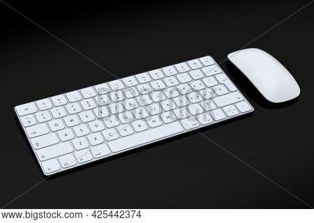 Modern White Aluminum Computer Keyboard And Mouse Isolated On Black Background.