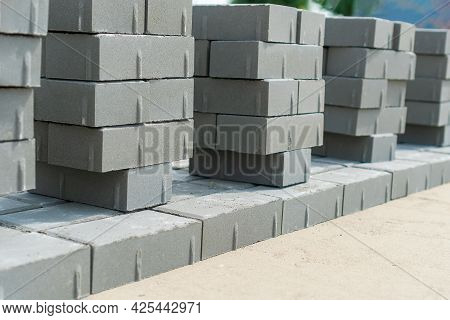 New Paving Slabs In Rows In Summer Close-up. Laying Of Paving Slabs