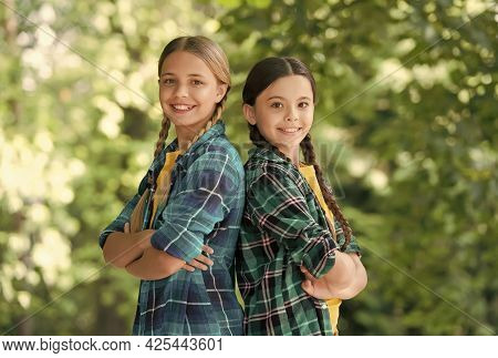 Happy Students. Best School Friends. Concept Of Friendship. Small Happy Girls Wear Checkered Shirt.