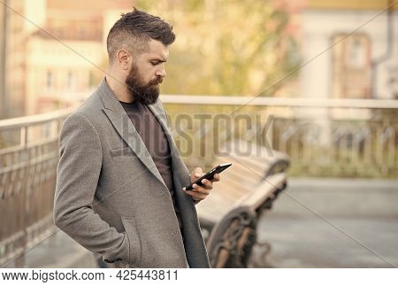 Reach People On The Go With Sms Marketing. Bearded Man Read Sms Urban Outdoors. Text Messaging. Mobi