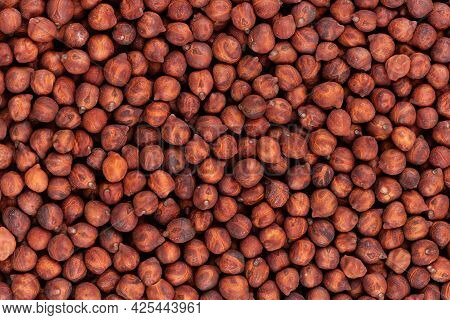 Brown Chickpeas Background. Red Chickpea Bean. Garbanzo, Bengal Gram Or Chick Pea Bean.