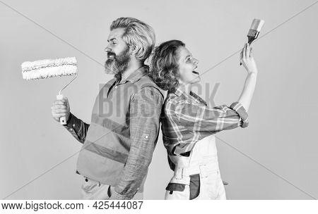 Painting Walls. Woman Builder. Man Painter Or Decorator. Interior Renovation. Decorating Apartment.