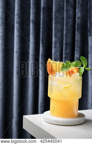 Freshness Mai Tai Classic Cocktail Or Lemonade With Lime, Orange Juice, Ice Cube And Mint On Curtain