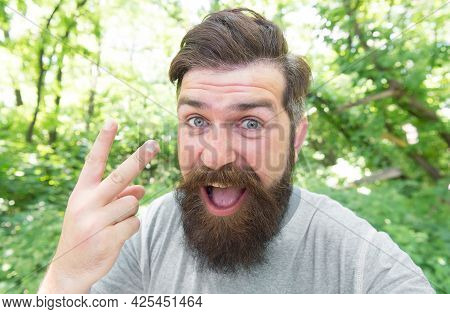 The Forks. Man Gesturing V Sign As Insult. Brutal Man Giving Offensive Gesture. Vulgar Man With Long