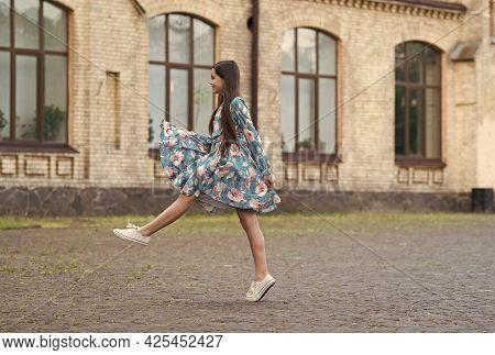 Girl Summer Dress Flutters In Motion Urban Background, Freshness Concept