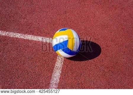 Volleyball. Blue With Yellow Color Ball On The Playground. Volleyball Cover, Red. Ball Game