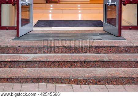 Marble Staircase With Granite Steps To Entrance Door On Store With Glass, Threshold With Doormat At