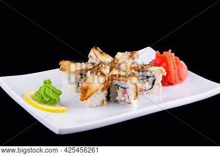 Unagi Kani - Sushi Roll With Crab, Eel, Tomato, Cucumber, Mayonnaise, Sesame Isolated On Black Backg
