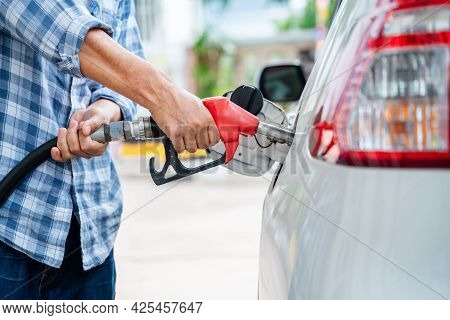 Close-up Hand Of Refuel The Car By Yourself, Pumping Equipment Gas At Gas Station.
