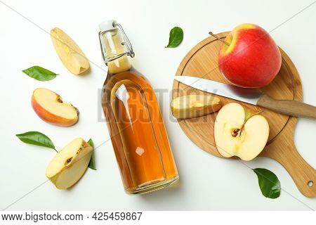 Homemade Apple Vinegar And Ingredients On White Background