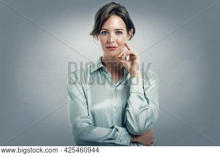 Happy Businesswoman Wearing Shirt While Standing At Isolated Grey Background