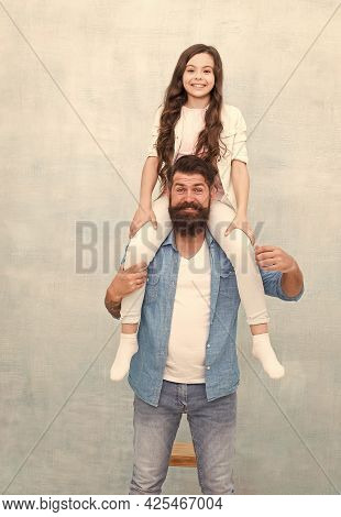Do What You Like. Baby Girl Enjoy Active Game With Father. Bearded Man Piggyback Small Child. Casual