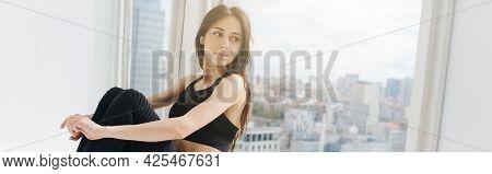 Dreamy Armenian Woman In Black Top Looking Through Window, Banner