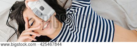 Top View Of Stylish Armenian Woman In Striped Pullover Taking Photo, Banner