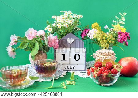 Calendar For July 10 : The Name Of The Month Of July In English, Cubes With The Number 10, Bouquets