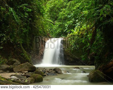 Slow Motion Of Waterfall And River In Forest Podocarpus National Park, Ecuador.