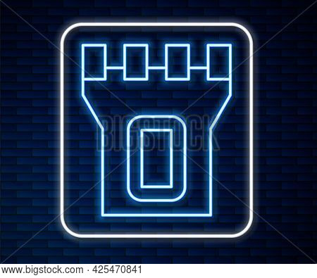Glowing Neon Line Castle Tower Icon Isolated On Brick Wall Background. Fortress Sign. Vector