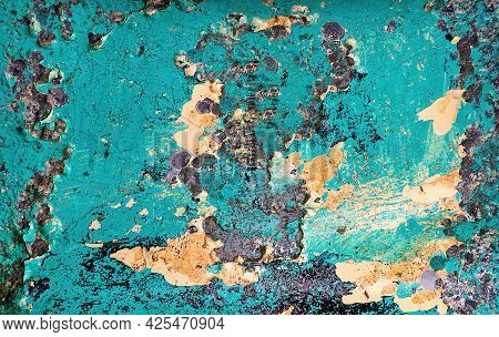 Close Up Peeling Turquoise Paint On Metal Surface With Rust