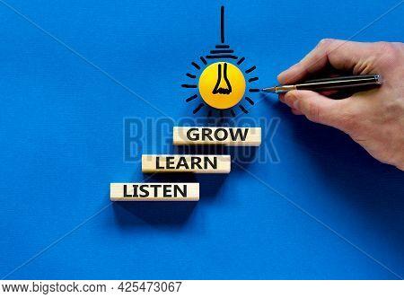 Listen, Learn, Grow Symbol. Wooden Blocks With Concept Words Listen, Learn, Grow. Blue Background. B