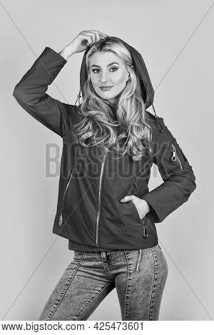Fashion Brunette Model In Nice Clothes. Wearing Jacket Or Coat. Fashion Studio Portrait Of Sportive