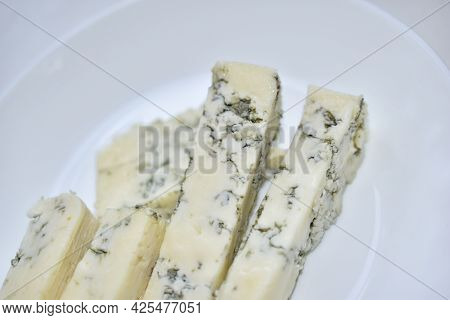 White Cheese With Blue Mold On A White Plate