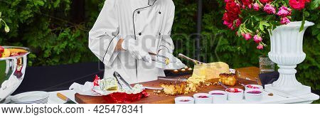 The Waiter Puts On The Plate Cheese Snacks. Aperitif, Catering At A Wedding Or Event.