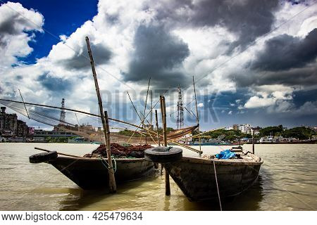 Traditional Fishing Boat On The Riverbank Under The Cloudy Sky, This Image Captured On September 21,