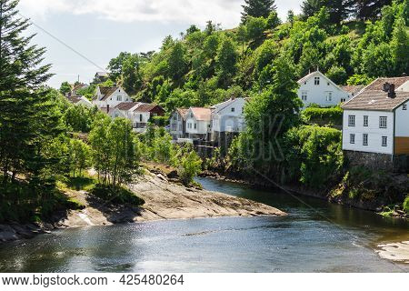 Norwegian White Houses On River Shore. Beautiful Village, Scandinavia Europe